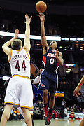 March 27, 2011; Cleveland, OH, USA; Atlanta Hawks guard Jeff Teague (0) shoots over Cleveland Cavaliers forward Luke Harangody (44) during the fourth quarter at Quicken Loans Arena. The Hawks beat the Cavaliers 99-83. Mandatory Credit: Jason Miller-US PRESSWIRE
