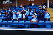 AFC Wimbledon youth team prior to kick off and watching the game during the EFL Cup match between AFC Wimbledon and Milton Keynes Dons at the Cherry Red Records Stadium, Kingston, England on 13 August 2019.