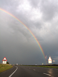 UK ENGLAND 6JUL08 - A rainbow forms during evere weather while driving on the A1M southbound from Newcastle, northern England...jre/Photo by Jiri Rezac..© Jiri Rezac 2008..Contact: +44 (0) 7050 110 417.Mobile:  +44 (0) 7801 337 683.Office:  +44 (0) 20 8968 9635..Email:   jiri@jirirezac.com.Web:    www.jirirezac.com..All images © Jiri Rezac 2008. All rights reserved.