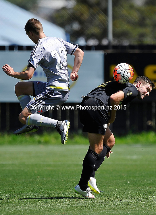 Matthew Ridenton (L) of the Phoenix Reserves tackles Chris Bale of Team Wellington during the ASB Premiere  - Team Wellington vs Phoenix football match at David Farrington Park in Wellington on Sunday the 20th of December 2015. Copyright Photo by Marty Melville / www.Photosport.nz