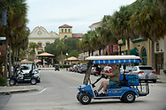 Residents drive golf carts through the main square of the Spanish Springs neighborhood in the retirement community of The Villages, Fla., Wednesday, Sept. 25, 2013.(AP Photo/Phelan M. Ebenhack)
