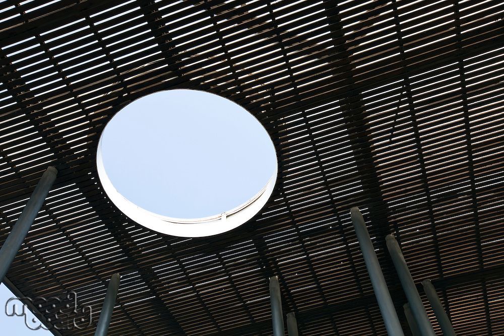 Circular hole in wooden walking deck