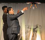 Houston ISD Superintendent Richard Carranza takes delivery of a water bottle from a drone during the State of the Schools luncheon at the Hilton of the Americas, February 15, 2017.