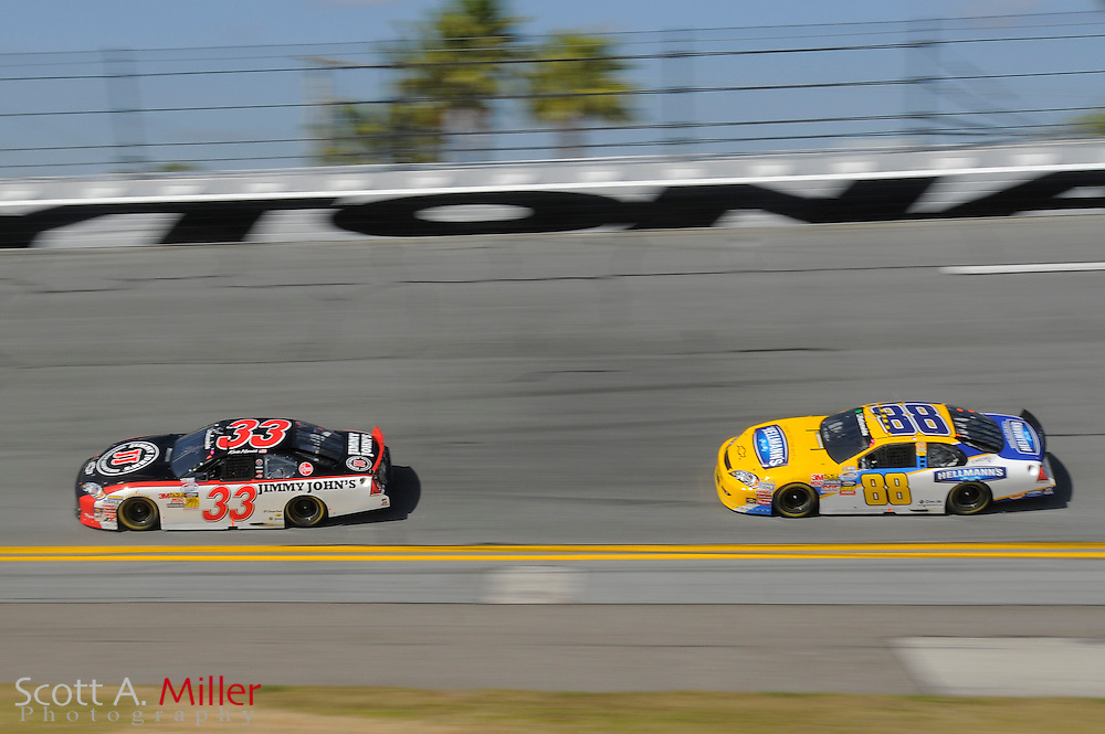 Feb. 13, 2010; Daytona Beach, FL, USA; Nationwide Series drivers Kevin Harvick (33) and Dale Earnhardt Jr. (88) head through turn 4 during the Drive4COPD 300  at Daytona International Speedway. ©2010 Scott A. Miller