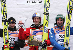 Adam Malysz (POL) placed second, Winner Gregor Schlierenzauer (AUT) and Dimitry Vassiliev (RUS) placed third at Flying Hill Individual in 2nd day of 32nd World Cup Competition of FIS World Cup Ski Jumping Final in Planica, Slovenia, on March 20, 2009. (Photo by Vid Ponikvar / Sportida)