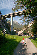 Cycling path passes under a viaduct at Imst, town in the Austrian federal state of Tyrol. It lies on the River Inn in western Tyrol,
