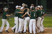 West Deptford teammates surround Ed Essig after Essig hit a homerun during the opening round of the Mid-Atlantic Senior League regional tournament held in West Deptford on Friday, August 5.t