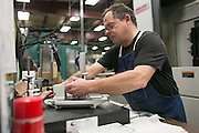 Gary Williams of Greece works at ATD Precision in Gates on Wednesday, December 16, 2015.