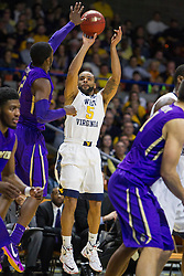 Nov 16, 2015; Charleston, WV, USA; West Virginia Mountaineers guard Jaysean Paige shoots a three pointer during the first half against the James Madison Dukes at the Charleston Civic Center. Mandatory Credit: Ben Queen-USA TODAY Sports