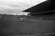 06/09/1964<br /> 09/06/1964<br /> 6 September 1964<br /> All-Ireland Senior Final: Tipperary v Kilkenny at Croke Park, Dublin.<br /> M. Keating, in possession, tries to break through Kilkenny's defence.