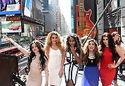 "Camila Cabello, Dinah Jane Hansen, Normani Kordei, Ally Brooke and Lauren Jauregui, left to right, of Fifth Harmony, pose on the marquee at Hard Rock Cafe New York, Thursday, Aug. 27, 2015, in Times Square to reveal the music video for their song, ""I'm In Love with a Monster,"" which will be featured in ""Hotel Transylvania 2.″ (Photo by Diane Bondareff/Invision for Hard Rock International/AP Images)"