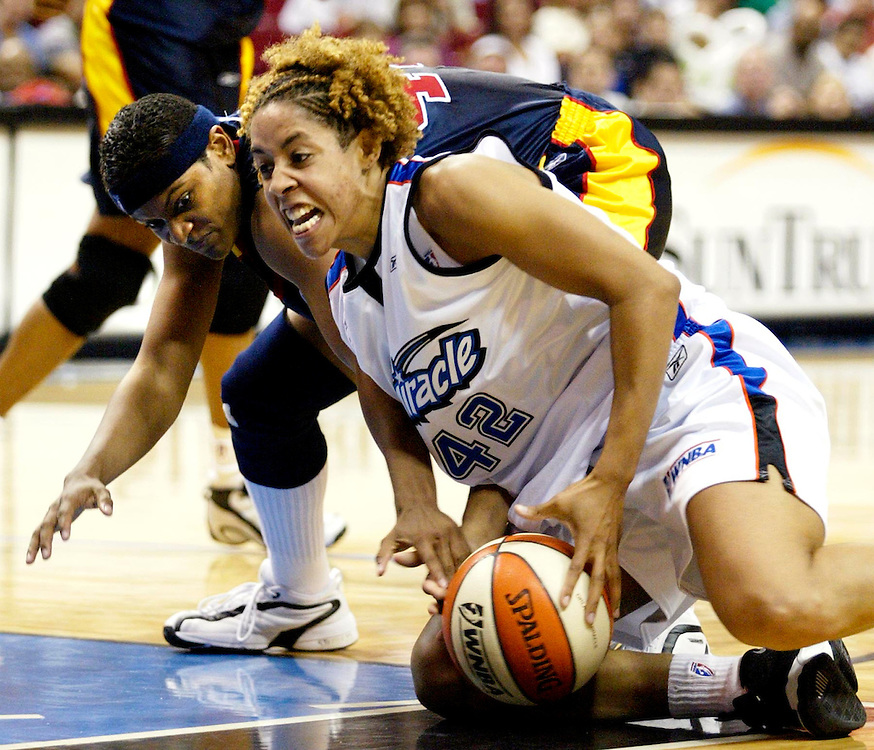 Orlando Miracle's Nykesha Sales (42) fights for control of a loose ball with Indiana Fever's Alicia Thompson (43) during the second half, Tuesday, June 11, 2002 at the TD Waterhouse Centre in Orlando, Fla. The Fever defeated the Magic, 75-69. (AP Photo/Scott Audette)