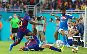 FC Barcelona defender Clement Lenglet (15) slide tackles the ball away from SSC Napoli midfielder Lorenzo Insigne (24) during a La Liga-Serie A Cup soccer match, Wednesday, Aug. 7, 2019, in Miami Gardens, Fla. FC Barcelona beat Napoli 2-1 (Kim Hukari/Image of Sport)