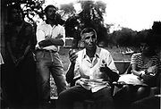 A group of ex-combatents explain their involvement in the civil war to a group of international solidarity visitors. Nueva Esperanza, El Salvador, 1999.