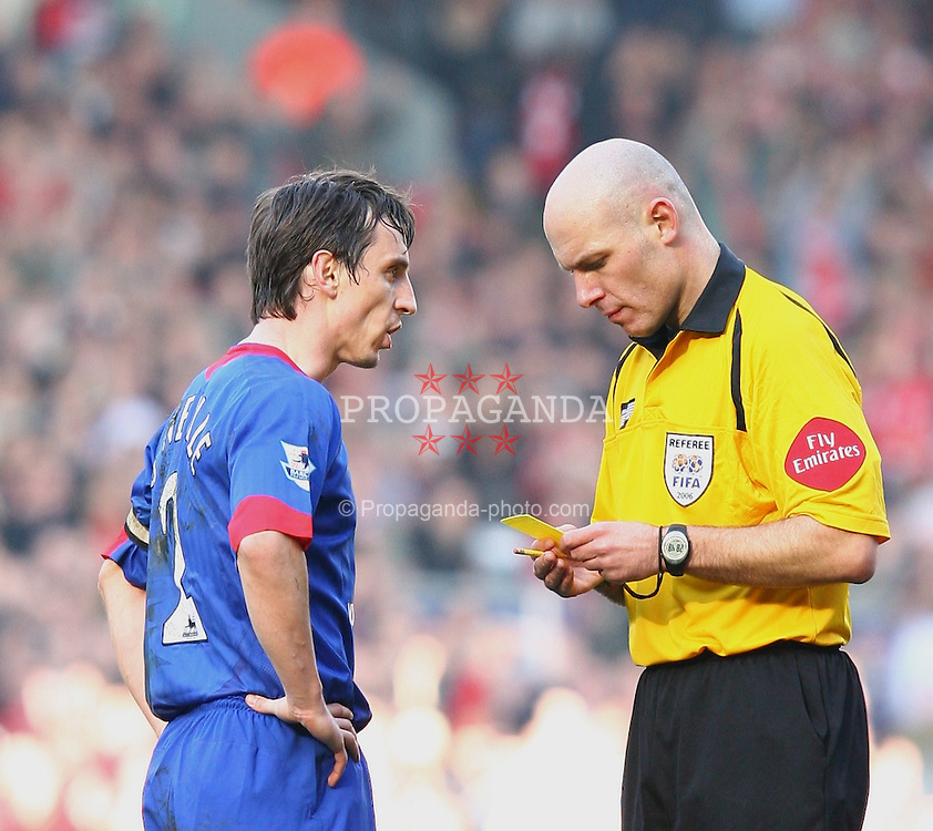 LIVERPOOL, ENGLAND - SATURDAY, FEBRUARY 18th, 2006: Manchester United's Gary Neville is shown the yellow card by referee Howard Webb after a tackle on Liverpool's Harry Kewell during the FA Cup 5th Round match at Anfield. (Pic by David Rawcliffe/Propaganda)