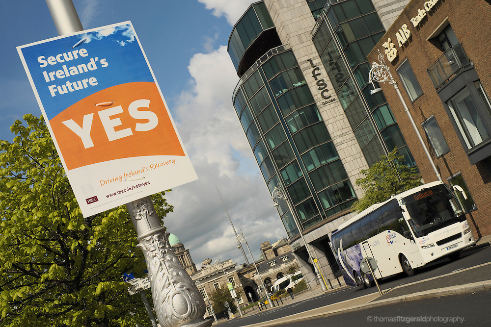 "A Vote Yes Poster for Irish Fiscal Treaty Referendum by the employer's group IBEC featuring the slogan ""Secure Ireland's Future"" as seen infront of the IFSC in Dublin"