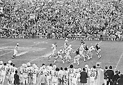 COLLEGE FOOTBALL:  Stanford quarterback Don Bunce #11 throws a pass during the 1972 Rose Bowl against Michigan played on January 1, 1972 at the Rose Bowl in Pasadena, California. Stanford won by a score of 13-12.  Other players visible include Stanford's Jackie Brown #33, Reggie Sanderson #32.  BW R0148-13