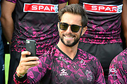Peter Trego takes a selfie while wearing sunglasses for one of the team shots in the Vitality Blast kit during the 2019 media day at Somerset County Cricket Club at the Cooper Associates County Ground, Taunton, United Kingdom on 2 April 2019.