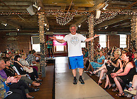 NH State Senator Andrew Hosmer entertains the crowd in his Nike apparel during the Belknap Mill Fashion & Flair Show on Sunday afternoon.  (Karen Bobotas/for the Laconia Daily Sun)