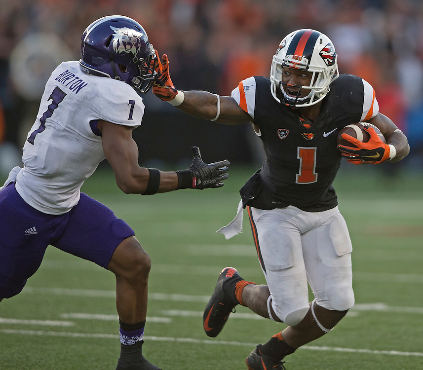 Oregon State runningback Chris Brown stiff arms Weber State's Josh Burton during the Beavers' 26-7 victory in the 2015 season opener in Reser Stadium, in Corvallis, on Friday, Sept. 4, 2015.