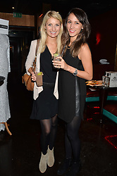 Left to right, TANIA McNALLY and DAANIA KARIM at a party in aid of the Youth at Risk charity held at Raffles, 287 King's Road, London on 27th November 2013.