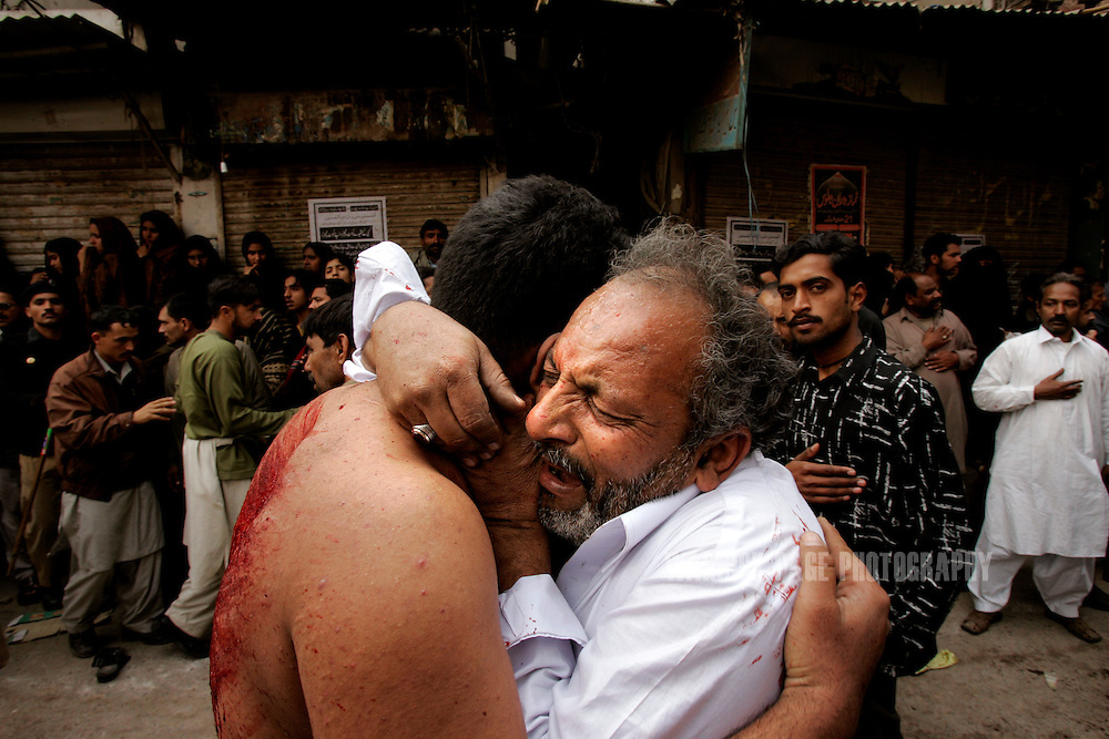 A father and son embrace in tears after participating in self-flagellation during Ashura rituals on January 30, 2007, in Lahore, Pakistan. Millions of Muslims worldwide observe Ashura during the month of Muharram to mourn the death of the Prophet Mohammed's grandson Immam Hussain. Some Shia participate in self-flagelation to punish themselves for failing to protect the prophet's grandson. Many Shia, however, see this act as unnecessary. During the month of Muharram, many Shia's give generously to the poor and spend time in prayer. Security is stepped up every year throughout the country during Ashura due to ongoing violence between Shia and Sunni Muslim groups who frequently attack during opposing religious observances. (Photo by Warrick Page)