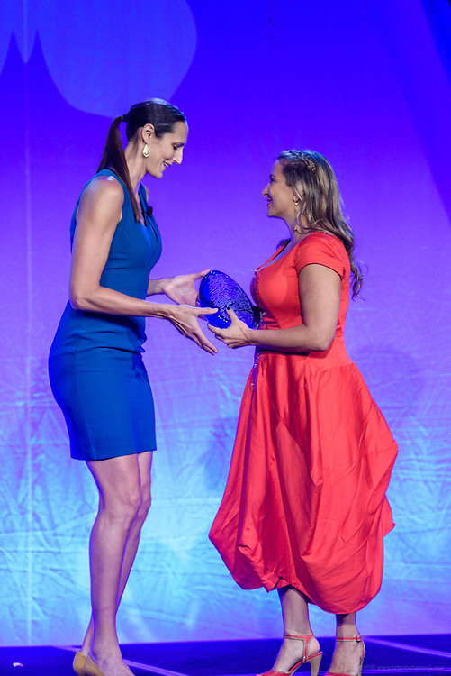 Ruth Riley, General Manager of the San Antonio Stars, former WNBA player, and NBA Cares Ambassador, presents Paige Elenson, global humanitarian and founder of the Africa Yoga Project, with the Muhammad Ali Humanitarian Award for Global Citizenship at the fifth annual Muhammad Ali Humanitarian Awards Saturday, Sept. 23, 2017, at the Marriott Louisville Downtown in Louisville, Ky. (Photo by Brian Bohannon/Invision for Muhammad Ali Center/AP Images)