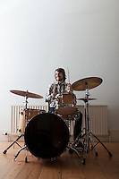 Young man plays drum set