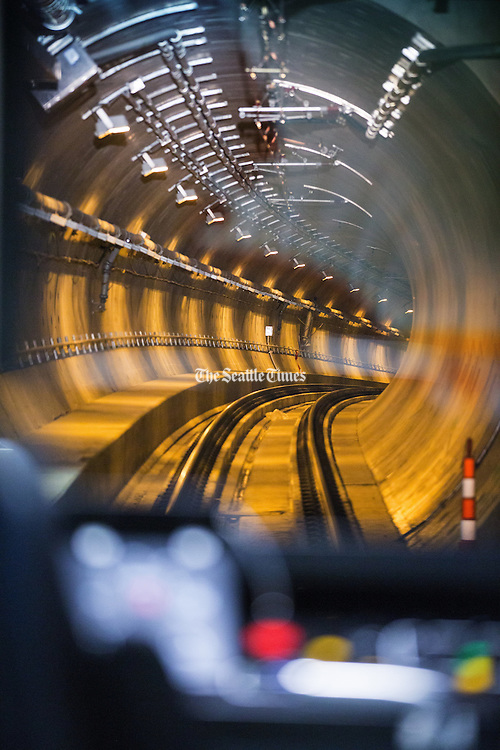 Photographed from the driver's seat,  Sound Transit's light rail tunnel heads north towards Husky Stadium. (Mike Siegel / The Seattle Times)