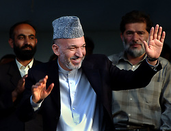 KABUL,AFGHANISTAN - SEPT. 2: Afghan President Hamid Karzai, together with representatives of the Ministry of Public Health, WHO and UNICEF kicked off a three-day nation wide immunisation campaign against polio September 2, 2002 in Kabul, Afghanistan.  The latest campaign will target 5.9 million children under the age of five and teams of vaccinators will go from village to village to ensure that all children in that age bracket are immunised. President Karzai adminstered the first drops of the Oral Polio Vaccine to an  Afghan child. (Photo by Ami Vitale/Getty Images)