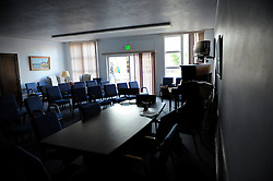 A homeless man enjoys some peace and quiet in a darkened room at the First United Methodist Church program in Salinas, California. Volunteers from the community provide meals, counseling resources and occasional shelter to many who have nowhere else to go. Basic rules, a generous spirit and a firm hand keep the program alive with minimal outside funding, creating real alternatives for a visible population in need.
