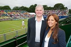 LIVERPOOL, ENGLAND - Wednesday, June 20, 2012: Tournament Referee Alan Mills with Liverpool City Cllr Anna Rothery during a kids' day at the Medicash Liverpool International Tennis Tournament at Calderstones Park. (Pic by David Rawcliffe/Propaganda)