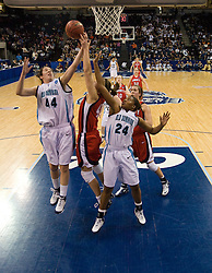 Old Dominion forward/center Megan Pym (44) grabs a rebound from Liberty guard/forward Megan Frazee (40).  The #5 seed Old Dominion Lady Monarchs defeated the #12 seed Liberty Flames 82-62 in the first round of the 2008 NCAA Division 1 Women's Basketball Championship in Norfolk, VA on March 23, 2008