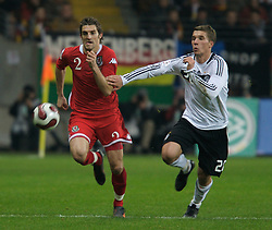 FRANKFURT, GERMANY - Wednesday, November 21, 2007: Wales' Sam Ricketts and Germany's Lukas Podolski during the final UEFA Euro 2008 Qualifying Group D match at the Commerzbank Arena. (Pic by David Rawcliffe/Propaganda)