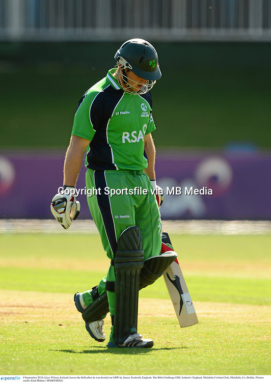3 September 2013; Gary Wilson, Ireland, leaves the field after he was bowled an LBW by James Tredwell, England. The RSA Challenge ODI, Ireland v England, Malahide Cricket Club, Malahide, Co. Dublin. Picture credit: Paul Mohan / SPORTSFILE