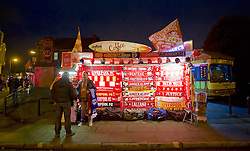 LIVERPOOL, ENGLAND - Thursday, November 26, 2015: A trader selling scarves outside Anfield ahead of the UEFA Europa League Group Stage Group B match between Liverpool and FC Girondins de Bordeaux. (Pic by David Rawcliffe/Propaganda)