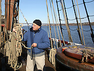 Newburgh, NY - Kipp van Aken, the chief engineer of the Half Moon, explains how sailors measured the depth of the river with a sounding line or lead line to visitors on the ship. The Half Moon, a full-scale, operating replica of the Dutch ship of exploration that Henry Hudson sailed in 1609, was docked on the Hudson River during the finale of the Newburgh Beacon Bay Quadricentennial celebration on Nov. 7, 2009.