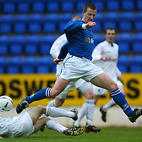 St Johnstone v Falkirk...03.04.04<br />Chris Hay is tackled by Scott MacKenzie<br /><br />Picture by Graeme Hart.<br />Copyright Perthshire Picture Agency<br />Tel: 01738 623350  Mobile: 07990 594431