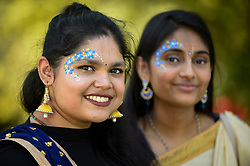 © Licensed to London News Pictures. 02/09/2018. WATFORD, UK.  Temple volunteers (L to R) Tanvi Madani and Diksha Desai pose for a photo as thousands of devotees attend the biggest Janmashtami festival outside of India at the Bhaktivedanta Manor Hare Krishna Temple in Watford, Hertfordshire.  The event, which celebrates the birth of Lord Krishna, includes a cultural and spiritual festival at a property donated to the Hare Krishna movement by ex Beatle George Harrison.  Photo credit: Stephen Chung/LNP
