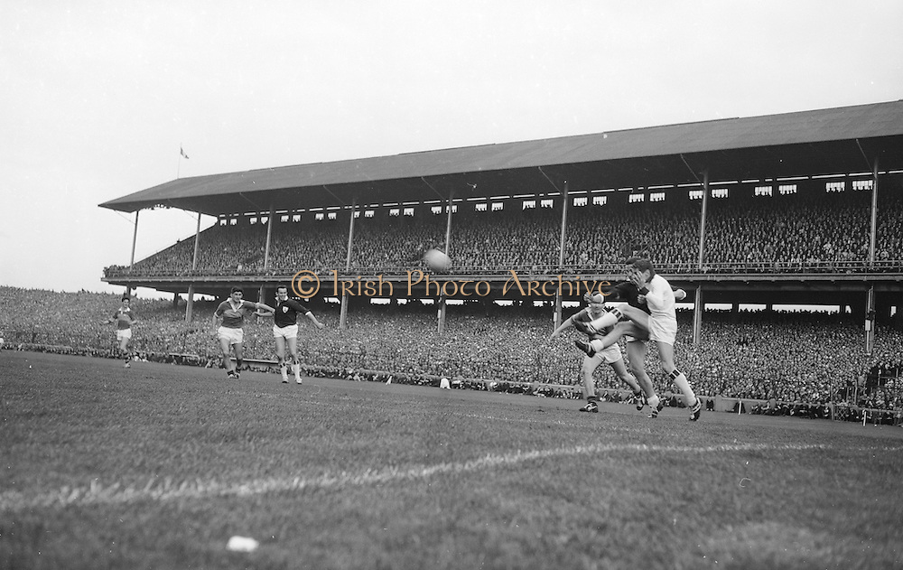 All Ireland Senior Football Championship Final, Kerry v Galway, 27.09.1964, 09.27.1964, 27th September 1964, Galway 0-15 Kerry 0-10, 27091964AISFCF,.Galway goalie J Gereghty takes flying kick at the ball to save in front of the goalmouth, with J.J. Barrett (Kerry) and E Colleran (Galway) close by,