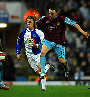 Photo: Paul Greenwood.<br />Blackburn Rovers v West Ham United. The Barclays Premiership. 17/03/2007.<br />West Ham's Mark Noble (R) clears the ball away from Tugay