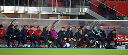 VIENNA, AUSTRIA - Thursday, October 6, 2016: Wales' bench during the 2018 FIFA World Cup Qualifying Group D match against Austria at the Ernst-Happel-Stadion. Hal Robson-Kanu, equipment manager David Griffiths, Paul Dummett, Tom Lawrence, goalkeeper Owain Fon Williams, Tom Bradshaw, Shaun MacDonald, Doctor Rhodri Martin, Joe Allen, sports science coach Adam Owen, James Collins, performance psychologist Ian Mitchall, Medical Officer Doctor Jon Houghton, physiotherapist Sean Connelly, head of performance Ryland Morgans. (Pic by David Rawcliffe/Propaganda)