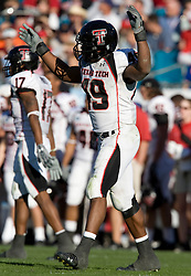 Texas Tech safety Joe Garcia (49) raises his arms in celebration during the Gator Bowl.  The Texas Tech Red Raiders defeated the Virginia Cavaliers 31-28 in the 2008 Konica Menolta Gator Bowl held at the Jacksonville Municipal Stadium in Jacksonville, FL on January 1, 2008.