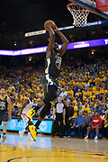 April 30, 2019; Oakland, CA, USA; Golden State Warriors forward Draymond Green (23) dunks the basketball against the Houston Rockets during the fourth quarter in game two of the second round of the 2019 NBA Playoffs at Oracle Arena. The Warriors defeated the Rockets 115-109.
