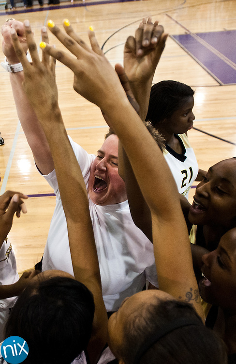 Concord head coach Angela Morton celebrates with her team after defeating Hickory Ridge in the championship game of the South Piedmont Conference Tournament Friday night. Concord defeated the Hickory Ridge 47-42. (Photo by James Nix)