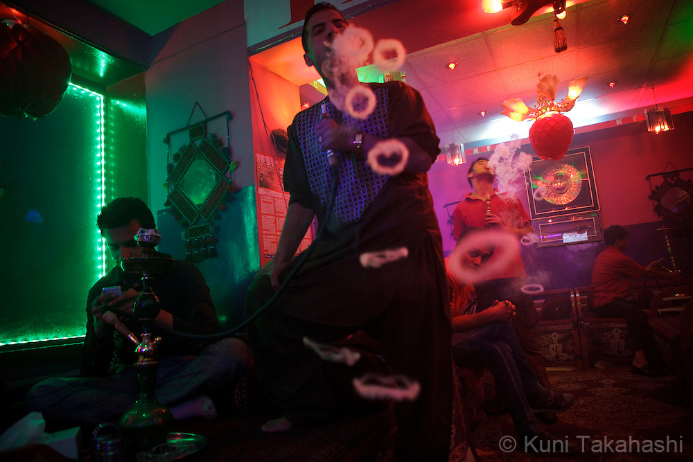 (Kabul Afghanistan - May 16, 2012).Men smoke shisha or water pipes at cafe in Kabul, Afghanistan on May 16, 2012. Shisha cafe is one of the few places Afghans go for relaxation in this war-torn country. .(Photo by Kuni Takahashi)