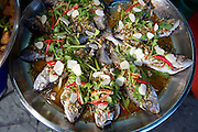Food stalls at Tha Thien Express Boat station. Fishes.
