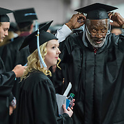 Pro Football Hall of Fame inductee and former Kansas City Chiefs linebacker Bobby Bell adjusted his cap next to fellow graduate Krista Schulte, left, prior to the graduation ceremony for the School of Kinesiology at Mariucci Arena on the University of Minnesota campus in Minneapolis on Thursday, May 14, 2015.