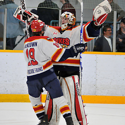 TRENTON, ON - Oct 26: Ontario Junior Hockey League game between Wellington Dukes and Trenton Golden Hawks. Coleman Foisy #30 and Joe McKeown #19 of the Wellington Dukes of the Wellington Dukes celebrate their shoot-out victory..(Photo by Shawn Muir / OJHL Images)