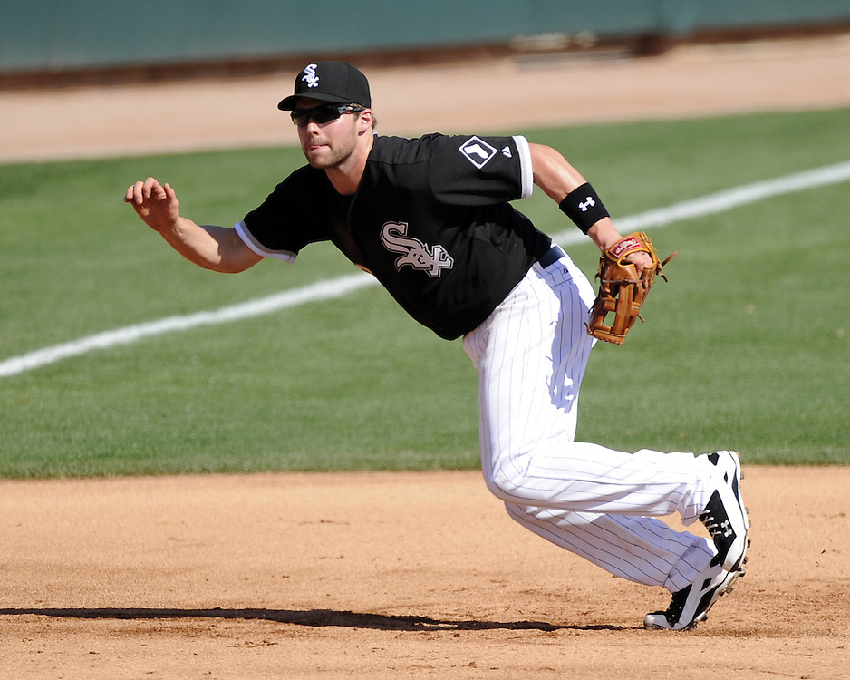 GLENDALE, AZ - MARCH 03:  Matt Davidson #22 of the Chicago White Sox fields against the Kansas City Royals on March 3, 2014 at The Ballpark at Camelback Ranch in Glendale, Arizona. (Photo by Ron Vesely)   Subject: Matt Davidson